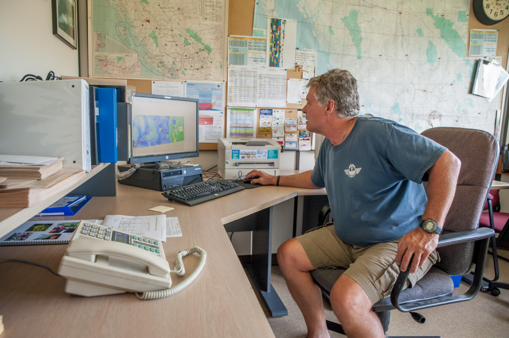 Ben MoerKoert, Air Attack officer, can see all wildfire activity and air attack crews in the province on a computer at the Penticton Airtanker Base. Before computers, communication was by radio. (Richard McGuire photo)