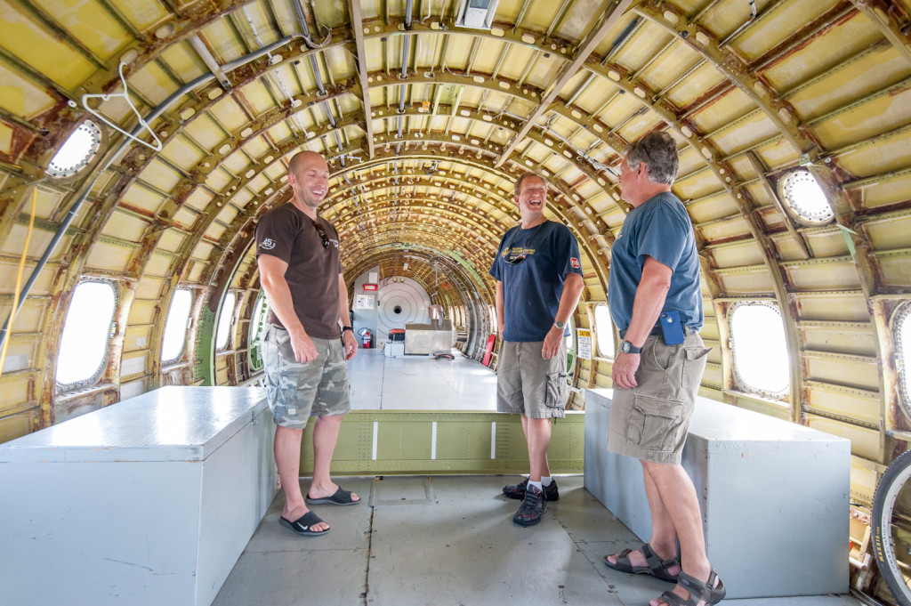 The insides of this Electra L188, now used as an air tanker, have been removed. One this turboprop plane carried passengers after it was built in the late 1950s. According to legend on the base, movie star Marilyn Monroe was once a passenger on this plane. From left Jeff Pulkinen, Pete Loeffler and Ben Moerkoert share a joke. (Richard McGuire photo)