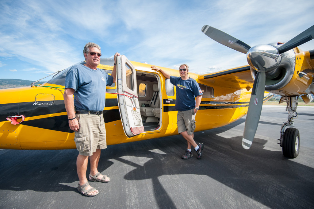 "The ""bird dog,"" a Rockwell Turbo Commander 690, is the flying command post when fighting fires. Ben Moerkoert (left) Air Attack officer, commands the attack and coordinates the planes, while Pete Loeffler pilots the plane. Loeffler is also a training captain. (Richard McGuire photo)"