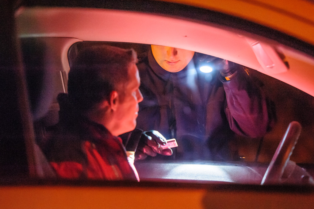 Const. Brad Chaput checks the drivers license of a man he's pulled over. Everything is fine, and the man is free to go. (Richard McGuire Photo)